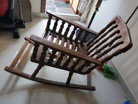 Slow swing wood chair