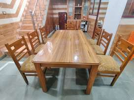 Wooden dining table with 7 cushioned wooden chairs