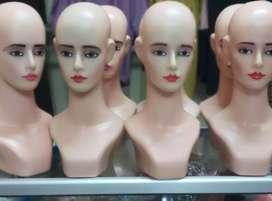 Patung kepala bekas