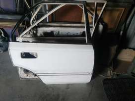 1988 corolla 4 doors front bumper and spoiler