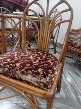 Beautiful cane dining table with chair and cusion