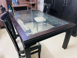 Glass dinning table with six chairs