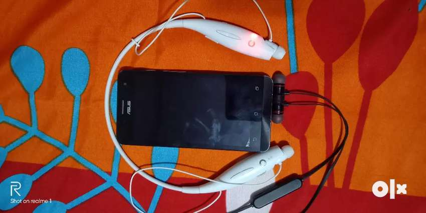 Asus Zenfone mobile..2 pieces Bluetooth earphone s free 0