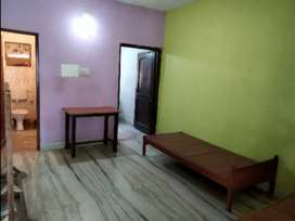 Semi furnished room with attached kitchen and toilet.