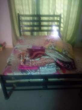 Almost new medium size iron bed for sale  with mattress