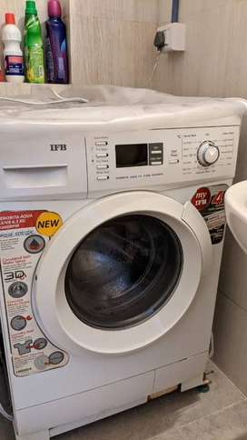 an excellent condition fully automatic front loading washing machine