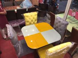 4 chairs loking gret and tabal