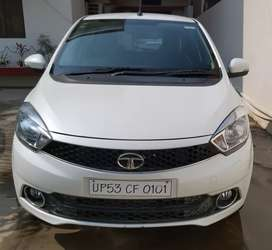 Tata tiago white. Very well maintained. Top model.