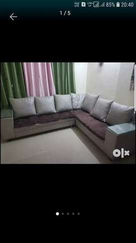 6 seater L Shape sofa with white granite center table.