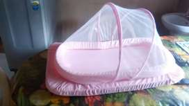 Baby bed with two baby covering sheets