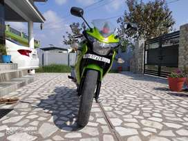 Honda CBR 150 r in green and black color with new rear wheel and disc