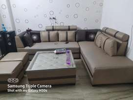 L shape sofa set with table and 2 puffies