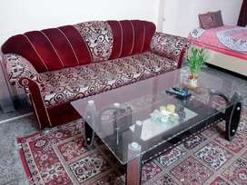 Sofa with table in a good state