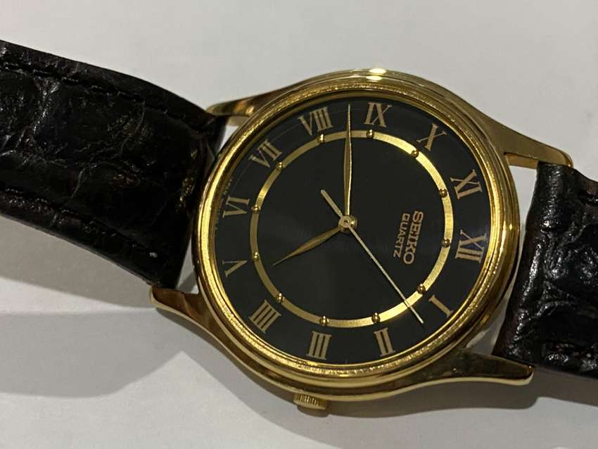 NEW,SEIKO SLIM GLD PLATED GENTS WATCH,1980's