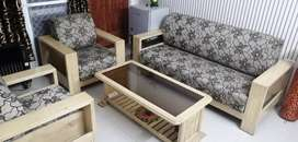 Five seater wooden frame sofa set with centre table in good condition