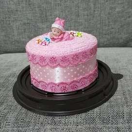 Souvenir handuk model kue tart