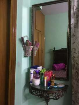Dressing mirror with wall table