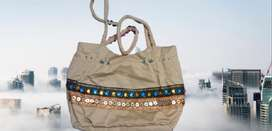 Good conditioned brown color Embroidery decorated handbag for women