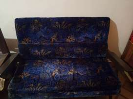 Blue cushioned sofa
