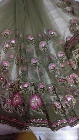 Sari in net, mehndi colour, in thread work