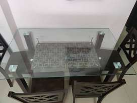 Glass 6-seater dining table along with 4 walnut wooden chairs