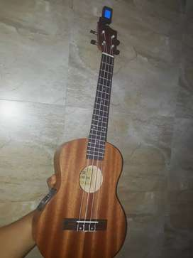 Kadence ukulele with equilizer,bag,digital tuner,tenor size