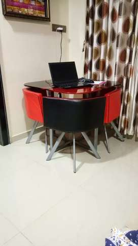 Tv base with dining table with 3 chairs
