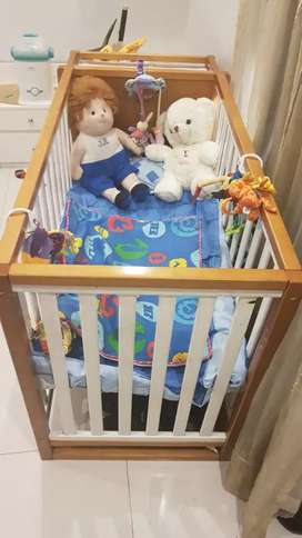 Baby cot with three racks