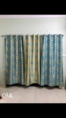 Printed curtains of 3 different designs.