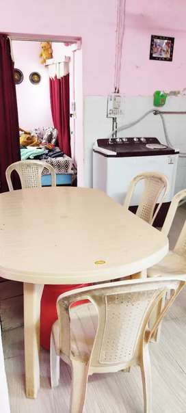 Plastic table with 6 chairs