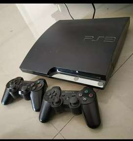 PS3 console and 2 controller with lots of games