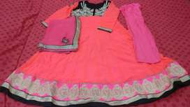 neon pink and black embroidered ladies suit.