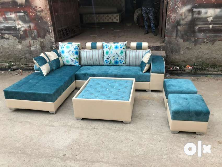 L shape sofa set with table & puffies 0