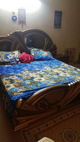 king size double bed with dressing table one show case and TV trolly.