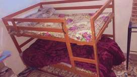 Double story well wooded bed