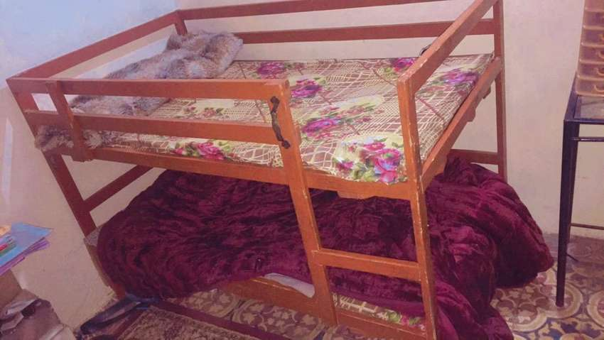 Double story well wooded bed for kidz of  6/8 years 0