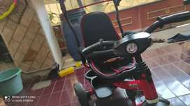 Sepeda anak roda tiga stroller headlight pacific warna merah
