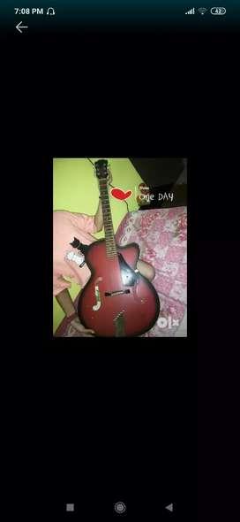 Red colour hobner guitar
