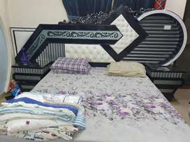 4 door cupboard, king size bed with side tables, and dressing table.