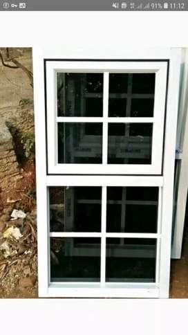 Jendela kaca aluminium warna putih yang elegan