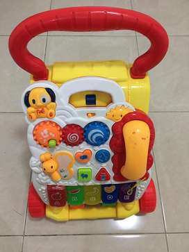 Toy and music baby walker