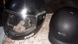 Two Helmets, one of studds (old), other of habsolite(new)