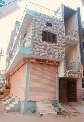 2 Floor Independent corner property with 3 Shops and Residence.