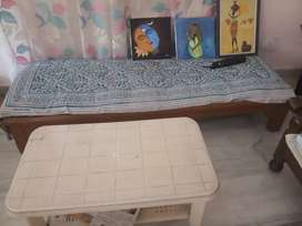 Plastic table and wooden sofa set