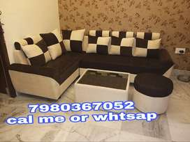 Brand new 5 seater corner sofa set with table in brown and cream color