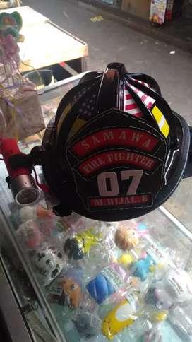 Helm pemadam kebakaran mumer