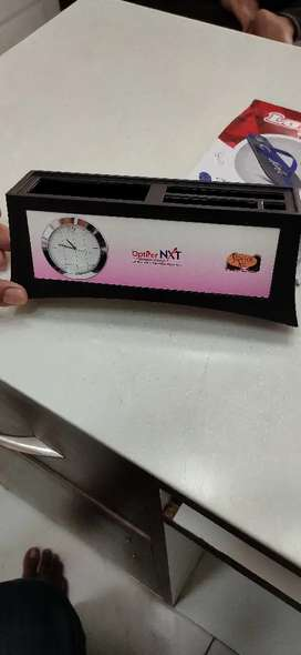 Watch with pen stand