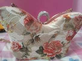Designer butterfly clutch