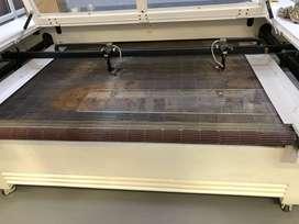 CNC DOUBLE HEADED LASER MACHINE