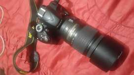 Nikon camera with dabal lenses and dabal battery  won charge and bags